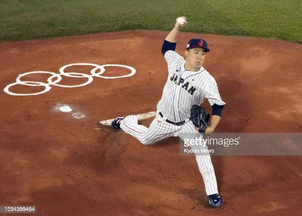 Masahiro Tanaka of Japan pitches against the United States in the second round of the Tokyo Olympic baseball tournament on Aug. 2 at Yokohama...