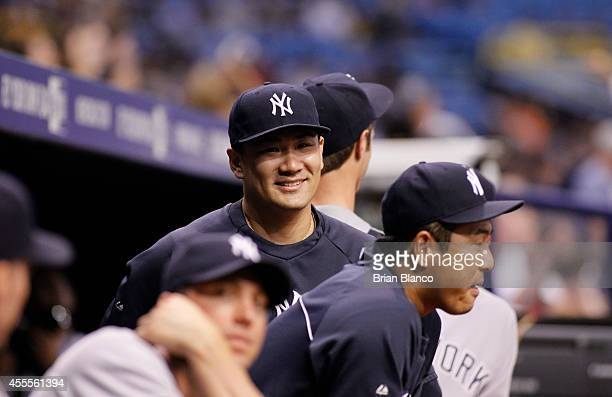 Masahiro Tanaka of the New York Yankees and Hiroki Kuroda look on from the dugout before the start of a game against the Tampa Bay Rays on September...