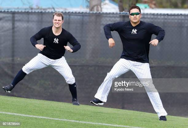 Masahiro Tanaka of the New York Yankees and his teammate Sonny Gray train on the slope at the team's spring training site in Tampa Florida on Feb 20...
