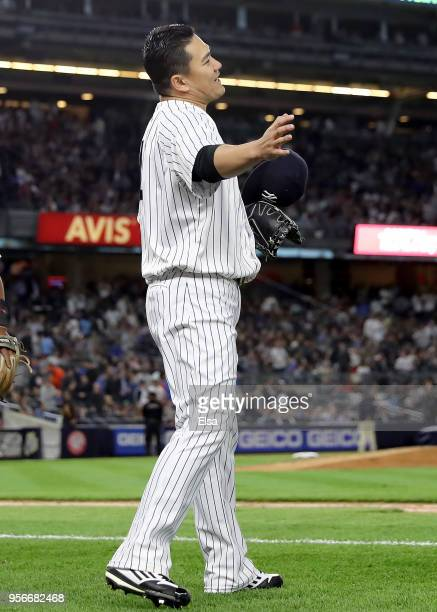 Masahiro Tanaka of the New York Yankees celebrates in the fifth inning after teammate Aaron Judge made a diving catch against the Boston Red Sox at...
