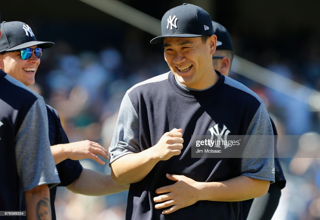 Masahiro Tanaka #19 of the New York Yankees celebrates with his teammates after defeating the Tampa Bay Rays at Yankee Stadium on June 16, 2018 in the Bronx borough of New York City.