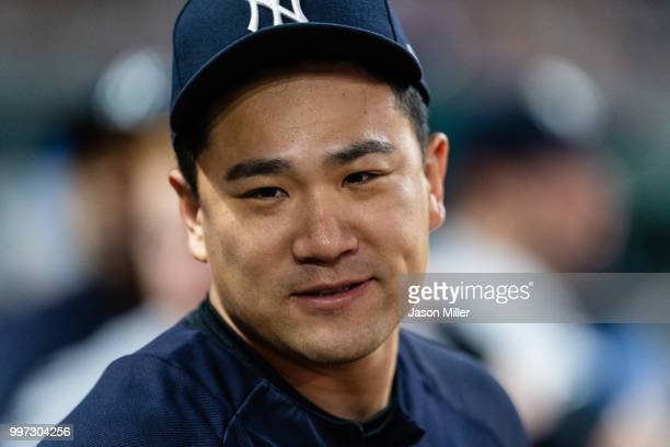 Masahiro Tanaka of the New York Yankees celebrates with teammates during the ninth inning against the Cleveland Indians at Progressive Field on July...