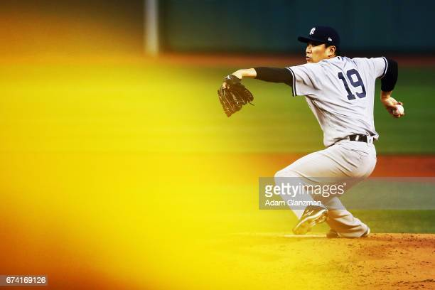 Masahiro Tanaka of the New York Yankees delievers in the first inning of a game against the Boston Red Sox at Fenway Park on April 27, 2017 in...