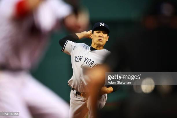 Masahiro Tanaka of the New York Yankees delievers in the first inning of a game against the Boston Red Sox at Fenway Park on April 27 2017 in Boston...