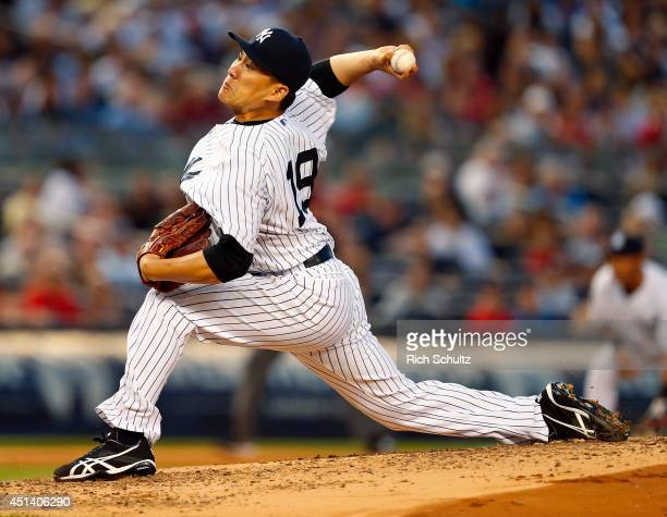 Masahiro Tanaka of the New York Yankees delivers a pitch against the Boston Red Sox during the fourth inning in a MLB baseball game at Yankee Stadium...