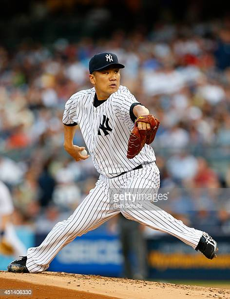 Masahiro Tanaka of the New York Yankees delivers a pitch against the Boston Red Sox during the first inning in a MLB baseball game at Yankee Stadium...