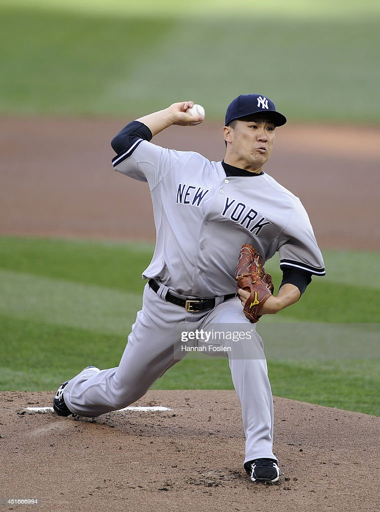 Masahiro Tanaka #19 of the New York Yankees delivers a pitch against the Minnesota Twins during the first inning of the game on July 3, 2014 at Target Field in Minneapolis, Minnesota.
