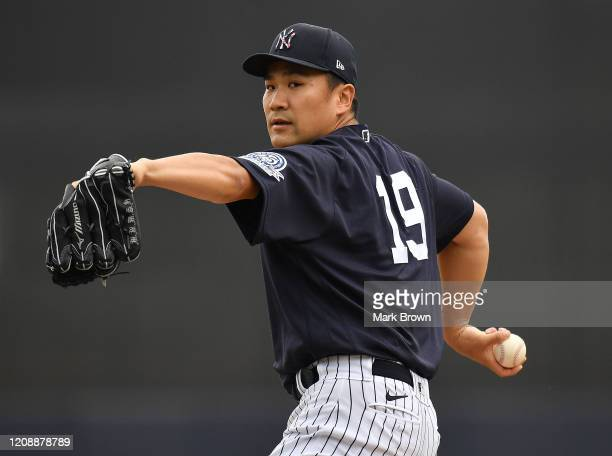 Masahiro Tanaka of the New York Yankees delivers a pitch before the first inning during the spring training game against the Washington Nationals at...