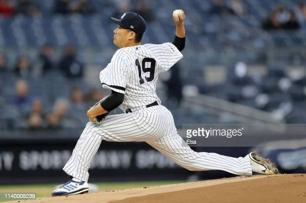 Masahiro Tanaka of the New York Yankees delivers a pitch in the first inning to Josh Harrison of the Detroit Tigers at Yankee Stadium on April 02...
