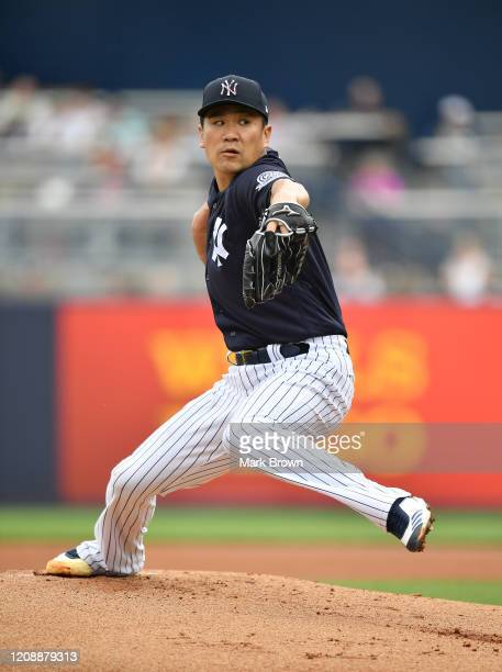Masahiro Tanaka of the New York Yankees delivers a pitch in the first inning during the spring training game against the Washington Nationals at...