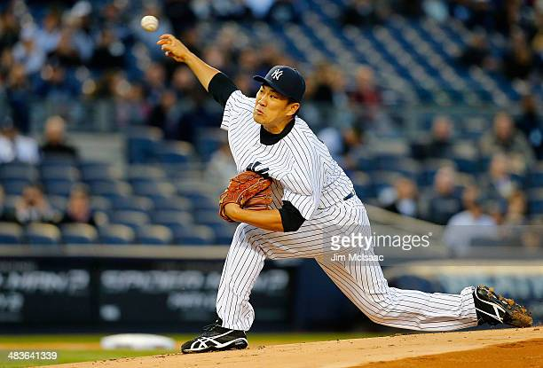 Masahiro Tanaka of the New York Yankees delivers a pitch in the first inning against the Baltimore Orioles at Yankee Stadium on April 9 2014 in the...