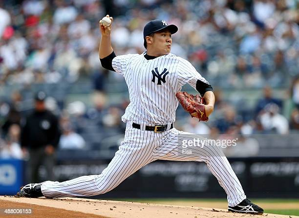 Masahiro Tanaka of the New York Yankees delivers a pitch in the first inning against the Tampa Bay Rays on May 3 2014 at Yankee Stadium in the Bronx...
