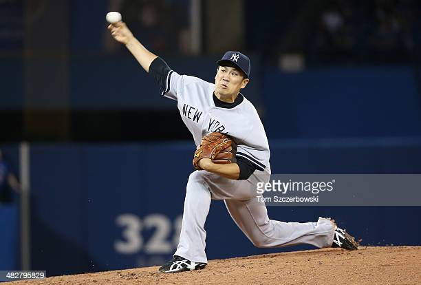 Masahiro Tanaka of the New York Yankees delivers a pitch in the second inning during MLB game action against the Toronto Blue Jays on April 4 2014 at...