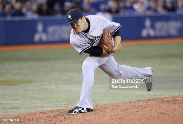 Masahiro Tanaka of the New York Yankees delivers a pitch in the second inning during MLB game action against the Toronto Blue Jays on April 4, 2014...
