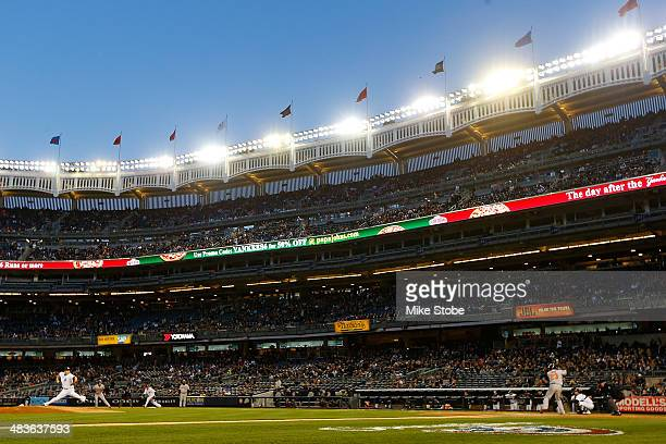 Masahiro Tanaka of the New York Yankees delivers a pitch in the second inning against the Baltimore Orioles at Yankee Stadium on April 9 2014 in the...