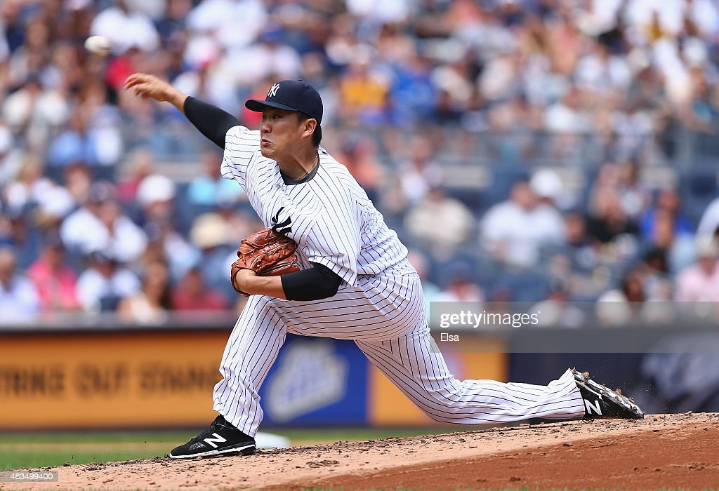 Masahiro Tanaka #19 of the New York Yankees delivers a pitch in the third inning against the Toronto Blue Jays on August 9, 2015 at Yankee Stadium in the Bronx borough of New York City.