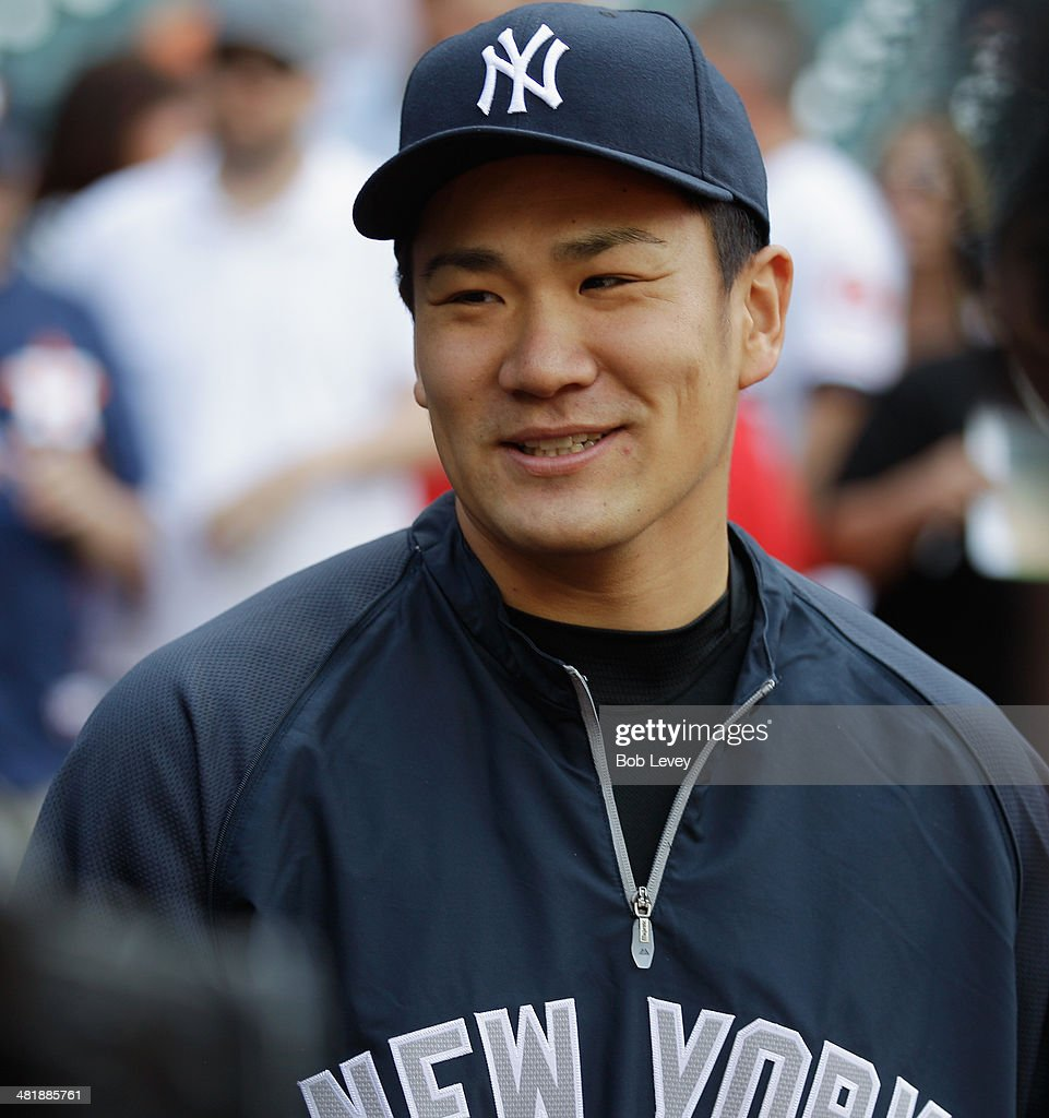 Masahiro Tanaka #19 of the New York Yankees during battting practice before a game against the Houston Astros on opening day at Minute Maid Park on April 1, 2014 in Houston, Texas.