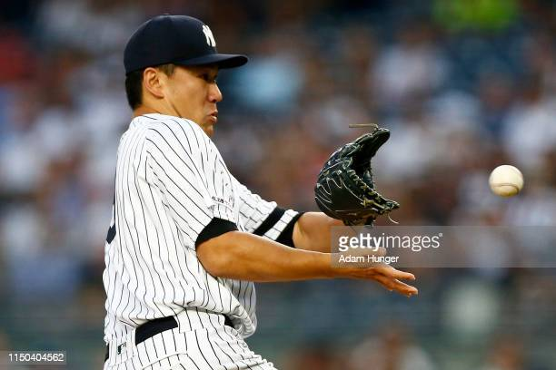 Masahiro Tanaka of the New York Yankees fields a ground out by Mike Zunino of the Tampa Bay Rays during the third inning at Yankee Stadium on June...