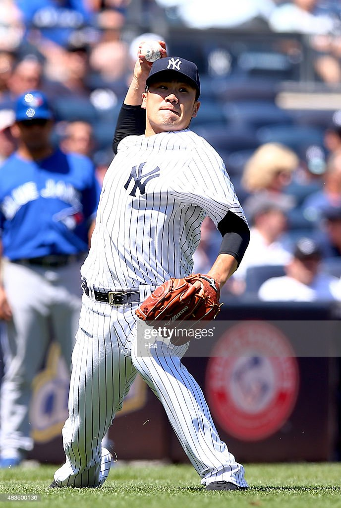 Masahiro Tanaka #19 of the New York Yankees fields a hit by Chris Colabello #15 of the Toronto Blue Jays in the fourth inning on August 9, 2015 at Yankee Stadium in the Bronx borough of New York City.