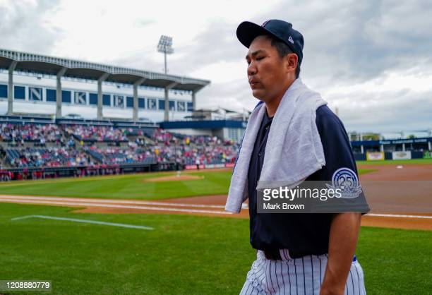Masahiro Tanaka of the New York Yankees heads to the dugout from the bullpen prior to the spring training game against the Washington Nationals at...