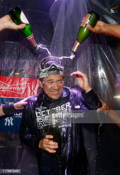 Masahiro Tanaka of the New York Yankees is doused with champagne after the New York Yankees clinched the American League East division title at...