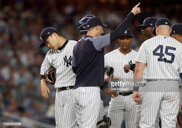 Masahiro Tanaka of the New York Yankees is removed from a game against the Boston Red Sox during the fifth inning by manager Aaron Boone at Yankee...