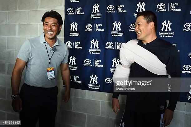 Masahiro Tanaka of the New York Yankees is seen with Atsunori Inaba of Hokkaido NipponHam Fighters at the New York Yankees Spring Training at George...