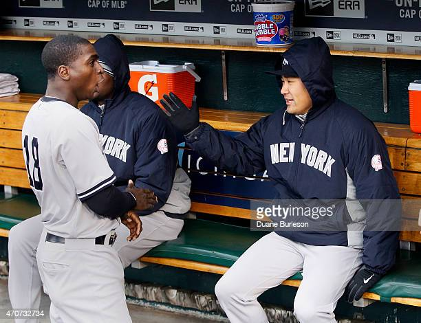 Masahiro Tanaka of the New York Yankees jokes with Didi Gregorius of the New York Yankees before their game against the Detroit Tigers at Comerica...