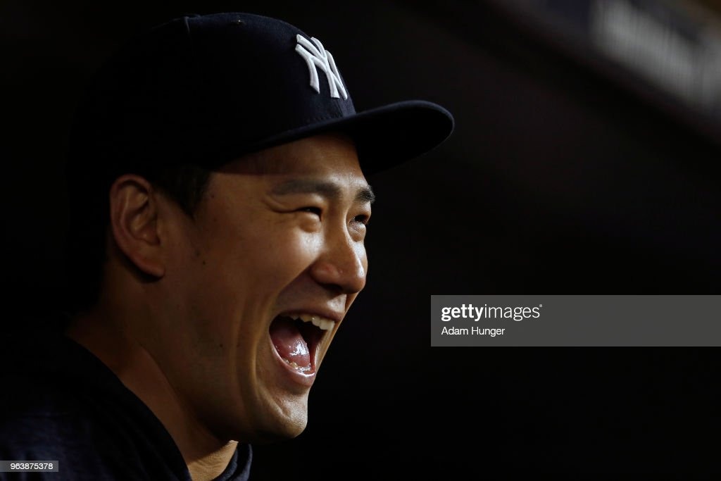 Masahiro Tanaka #19 of the New York Yankees laughs in the dugout against the Houston Astros during the eighth inning at Yankee Stadium on May 30, 2018 in the Bronx borough of New York City.