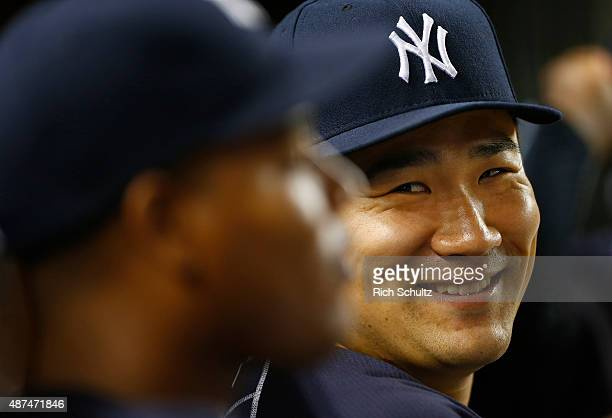 Masahiro Tanaka of the New York Yankees laughs in the dugout during the sixth inning of a MLB baseball game against the Baltimore Orioles at Yankee...