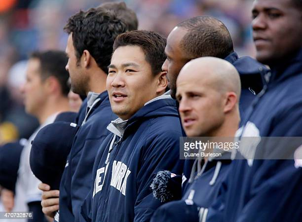 Masahiro Tanaka of the New York Yankees lines up with his teammates during the National Anthem before their game against the Detroit Tigers at...