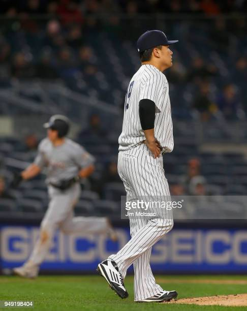 Masahiro Tanaka of the New York Yankees looks on after surrendering a home run against JT Realmuto of the Miami Marlins at Yankee Stadium on April 17...