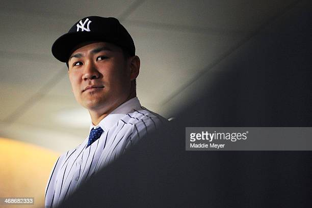 Masahiro Tanaka of the New York Yankees looks on during his introductory press conference at Yankee Stadium on February 11 2014 in New York City