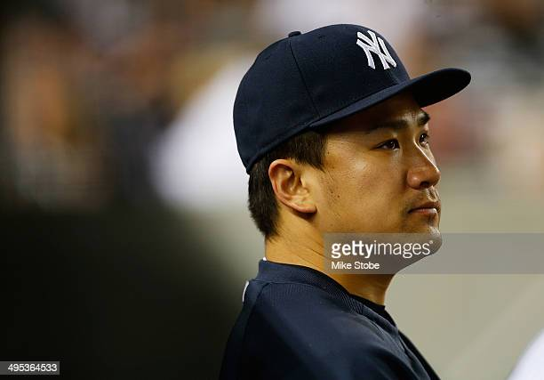 Masahiro Tanaka of the New York Yankees looks on from the bench in the seventh inning against the Seattle Mariners at Yankee Stadium on June 2 2014...