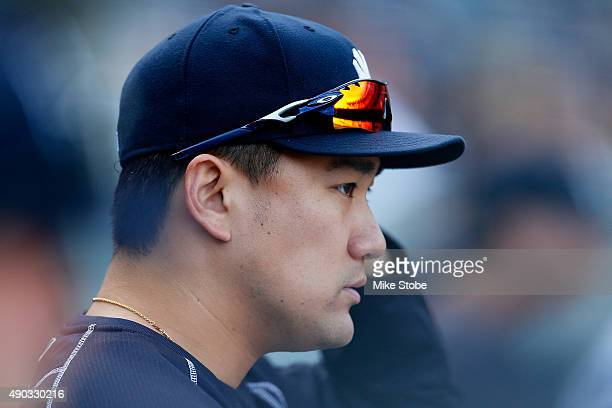 Masahiro Tanaka of the New York Yankees looks on from the bench against the Chicago White Sox in the eighth inning at Yankee Stadium on September 27...