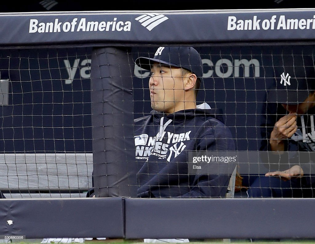 Masahiro Tanaka #19 of the New York Yankees looks on from the dugout in the first inning against the Kansas City Royals at Yankee Stadium on May 11, 2016 in the Bronx borough of New York City.