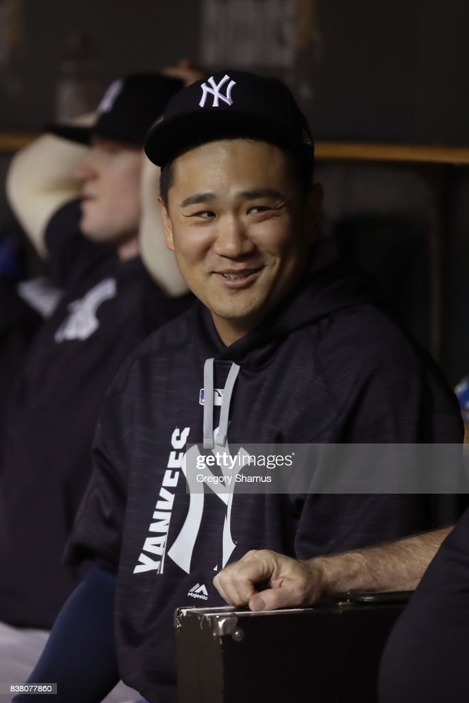 Masahiro Tanaka #19 of the New York Yankees looks on from the dugout while playing the Detroit Tigers at Comerica Park on August 23, 2017 in Detroit, Michigan.