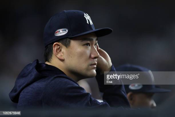 Masahiro Tanaka of the New York Yankees looks on from the dugout against the Boston Red Sox during Game Four American League Division Series at...