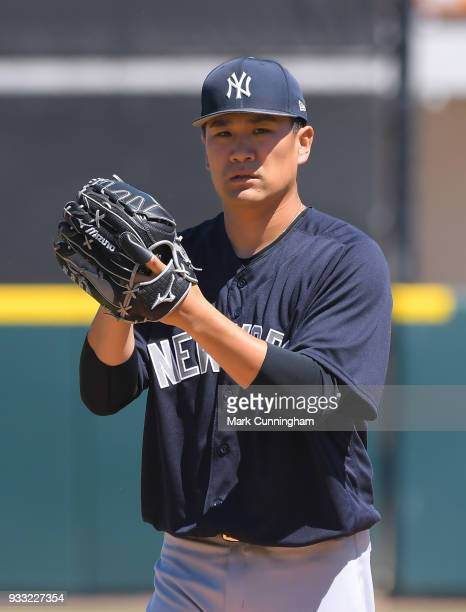 Masahiro Tanaka of the New York Yankees looks on in the first inning of the Spring Training game against the Detroit Tigers at Publix Field at Joker...