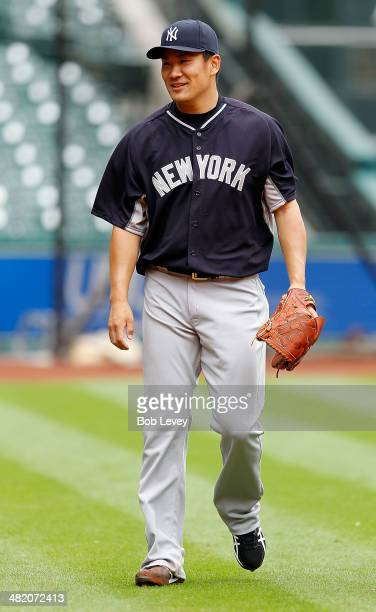 Masahiro Tanaka of the New York Yankees makes his way from the bullpen after a pitching session before a game against the Houston Astros at Minute...