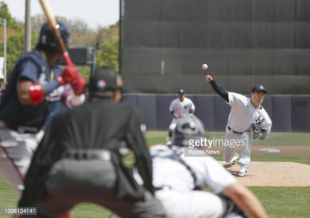 Masahiro Tanaka of the New York Yankees pitches against the Atlanta Braves in a spring training game in Tampa, Florida, on March 8, 2020.