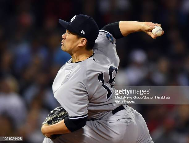 Masahiro Tanaka of the New York Yankees pitches against the Boston Red Sox in the second inning of Game 2 of Major League Baseball's American League...