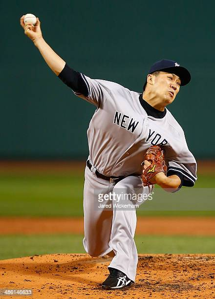Masahiro Tanaka of the New York Yankees pitches against the Boston Red Sox in the first inning during the game at Fenway Park on April 22 2014 in...