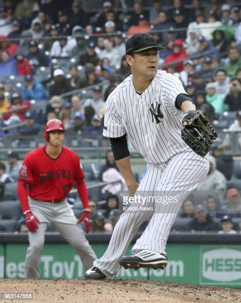Masahiro Tanaka of the New York Yankees pitches against the Los Angeles Angels after having Shohei Ohtani walk during the fourth inning of a game at...