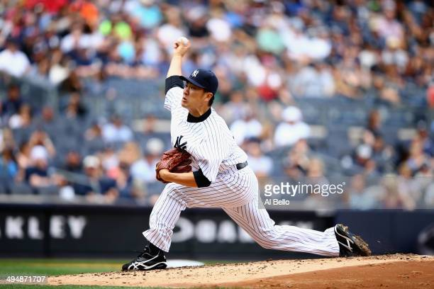 Masahiro Tanaka of the New York Yankees pitches against the Minnesota Twins in the second inning during their game at Yankee Stadium on May 31 2014...