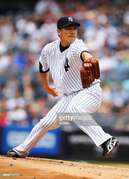 Masahiro Tanaka of the New York Yankees pitches against the Minnesota Twins in the first inning during their game at Yankee Stadium on May 31, 2014...