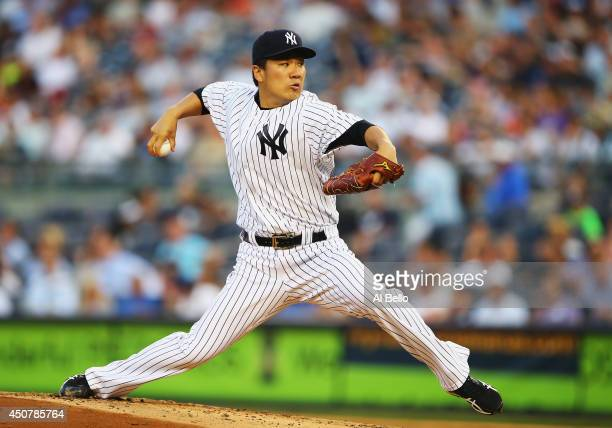 Masahiro Tanaka of the New York Yankees pitches against the Toronto Blue Jays in the first inning during their game at Yankee Stadium on June 17 2014...
