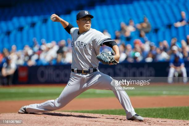 Masahiro Tanaka of the New York Yankees pitches during the first inning of MLB action against the Toronto Blue Jays at Rogers Centre on August 11...