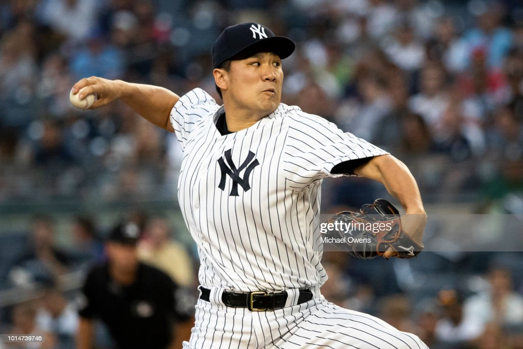 Masahiro Tanaka #19 of the New York Yankees pitches during the first inning against the Texas Rangers during their game at Yankee Stadium on August 10, 2018 in New York City.
