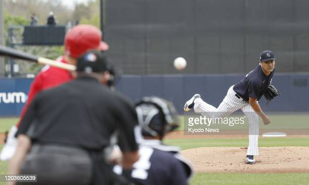 Masahiro Tanaka of the New York Yankees pitches in a spring training game against the Washington Nationals on Feb 26 in Tampa Florida